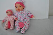Two Baby Dolls wearing multi-colored Pajamas