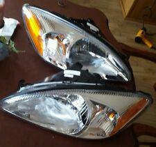 VAIP FD10084A1L/FD10084A1R left & right headlights Ford Taurus 00-06