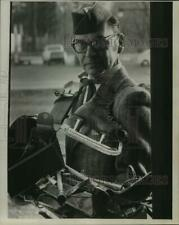 1969 Press Photo Len Sellner with ice skates around neck, carries other items