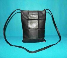 sac LUPO Barcelona en cuir noir porté épaule ou travers