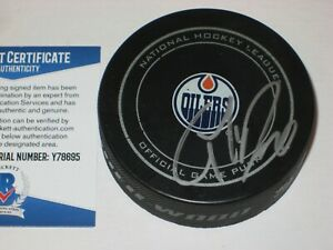 CONNOR McDAVID Signed Edmonton OILERS Official GAME Puck w/ Beckett COA
