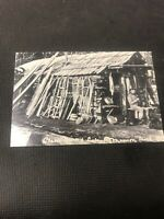 postcard Manson Creek A Miner's Cabin With Man And Dog Pioneer Card Repro  I01