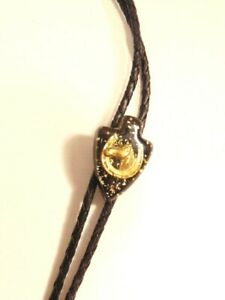 pre-owned black bolo tie with resin arrowhead slide with horse & horse shoe