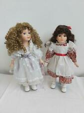 set of two 16 inch Knightsbridge Collection Porcelain Dolls with stands