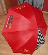 Autogramm Michael Schumacher auf Regenschirm