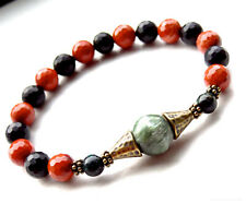 Faceted onyx and red jasper bracelet w/ seraphinite bronze beads