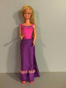 Skipper - blonde; tnt; bent arms; pink & purple ensemble; 1980s