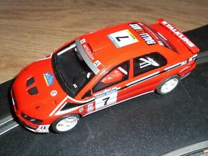 SCX Scalextric Mitsubishi Lancer 4 wheel drive rally car superb with lights