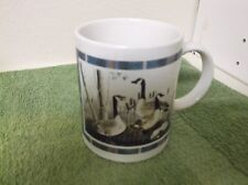 Houston Foods Present Canandian Goose Picture inside plaid trim Coffee Mug