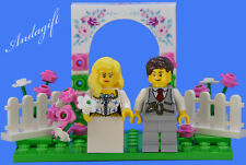 LEGO pink wedding set cake topper with bride and groom