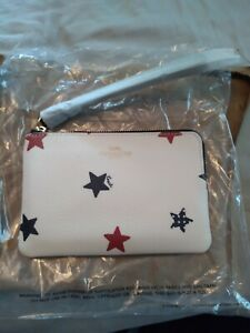 Coach wristlet new with tags. White with blue and red stars.