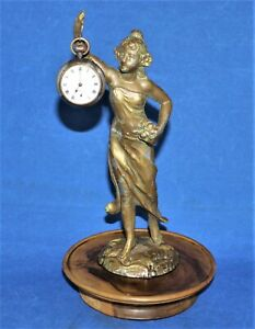 Vintage pocket watch stand and watch.