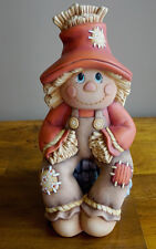Ceramic Bisque Ready to Paint Scarecrow sitting on a stump