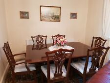 Mahogany extending dining table and six chairs.