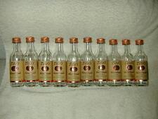 (12) TITO'S HANDMADE VODKA 50ML GLASS BOTTLES AUSTIN TEXAS (EMPTY)  W/CAPS!!!