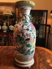 A Large Chinese Qing Dynasty Famille Rose Porcelain Vase with Wooden Stand.