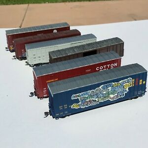 LOT of SEVEN Box Cars Assorted Manufactures & Roads Weathering Graffiti USED