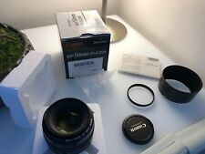 Canon EF 50mm f/1.4 USM lens with ES-71II lens hood and Canon Uv Filter