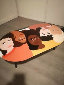 Upcycled coffee table with faces of beautiful women