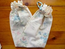 PLASTIC BAG HOLDERS IN CREAM WITH BLUE FLOWERS