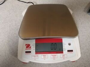OHAUS Digital Scale Model # NV4101 New in box. Maximum weight 4100 grams.