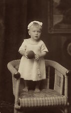 BAREFOOT ADORABLE LITTLE GIRL HOLDING  BALL AND STANDING ON A CHAIR (VINT. RPPC)