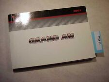 2003 Pontiac Grand Am Owners Manual in Good condition. 7724-61