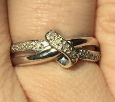 0.10 Carats genuine sparkling diamonds 9K White Gold twist design ring size L