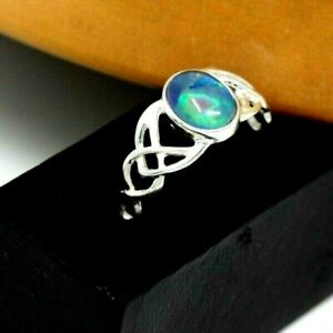A sterling silver Celtic ring  with an Opal triplet,in size O