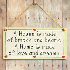 A House is made of bricks and beams. A Home is made of love and dreams wood sign