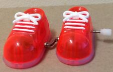 1980's Tomy vintage Phantom Feet Windup walking toy neon orange shoes sneakers
