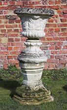 Large classical antique cast stone planter urn on plinth