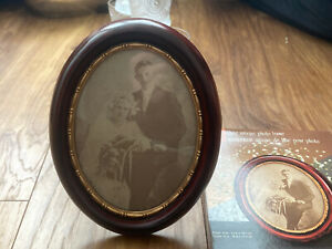 """antique style oval photo frame freestanding or wall hung approx 8.5x6.5"""""""