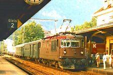 PHOTO  SWISS RAILWAYS - BLS CLASS RE4/4 170 ENTERS INTERLAKEN WEST WITH AN EVENI