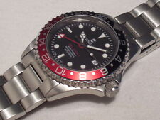 STEINHART GMT OCEAN ONE AUTOMATIC, 300M DIVER, BLACK/RED BEZEL, SWISS ETA 2893-2