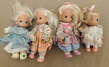 Lot of 4 Precious Moments Dolls