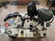 Canon camera bundle 3 Cameras, Lots Of Accessories And Carrying Cases
