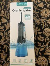 portable oral irrigator