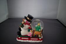 Christmas Snowman On A Sleigh Snow Globe