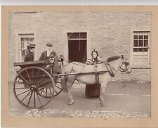 Cab photo Elderly couple, young lady in 2 wheeled cart drawn by pony