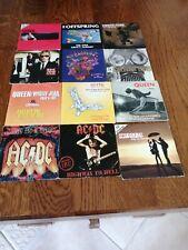 Lot 12 Cd single Pop Rock   QUEEN AC/DC  SCORPIONS U2  PORTISHEAD