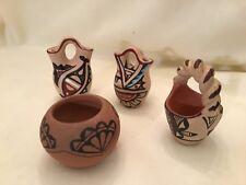 Lot# 1100.  Four Jemez pottery miniatures, 3 of them signed