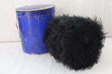 Ancien manchon en fourrure astrakan noir, avec sa boite Le Printemps