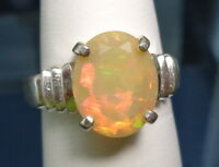 1.77ct ETHIOPIAN WELO OPAL 11x9mm Oval 925 Sterling Silver 3-Slash Ring Size 7