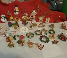 42 VINTAGE CHRISTMAS BROOCHES TREES, WREATHS, SANTAS AND OTHERVARIOUS DESIGNS