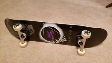 Rare Aws x Nike Sb Omar Salazar Skateboard and Silver skate tool.