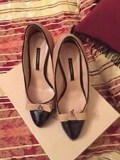 scarpe decoltè trapuntata beige e nera(bicolore) in pelle elegantissime,ciondolo