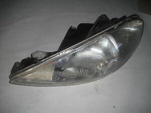 optique, phare avant de peugeot 206  coté conducteur , 9640559580 (ref 2589)