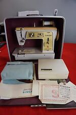 Vintage Singer Magic Bobbin sewing machine with case, manuals, accessories