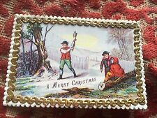1868 christmas card - father chopping a tree